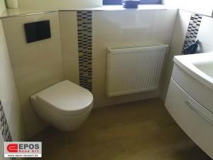 Die großformatigen Fliesen im Badezimmer und WC